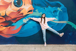 happy-woman-dancing-front-colorful-graff