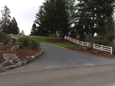 Rock wall and Asphalt Driveway