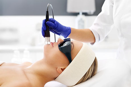 Laser treatment for the face. A woman in