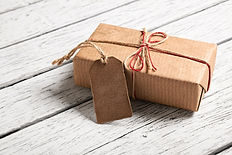 Gift box with blank gift tag on white wo