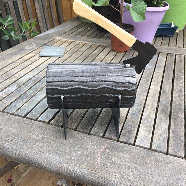 Small metal log and axe