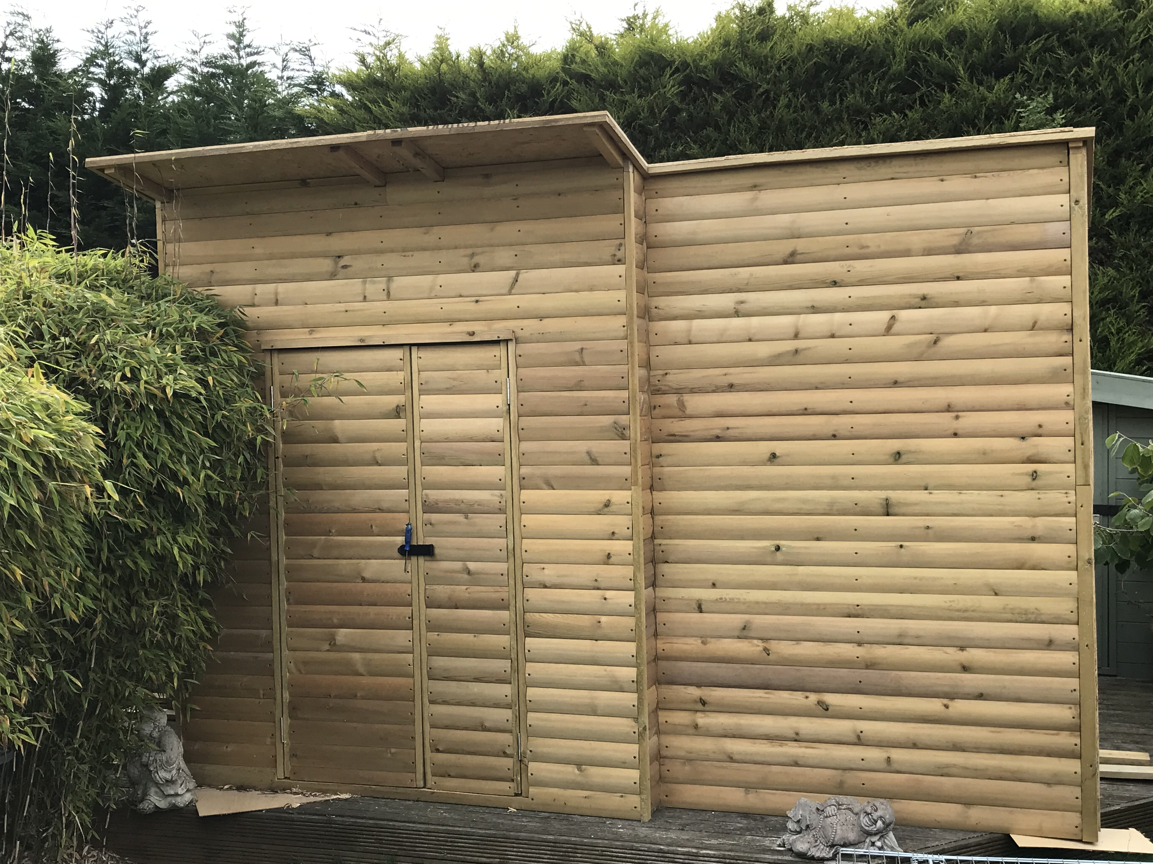 bespoke shed to fit around a tree