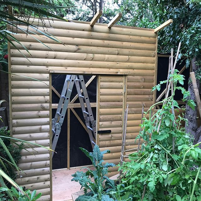 Bespoke shed being fitted snugly to its