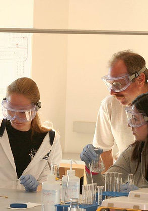 students and professor in lab