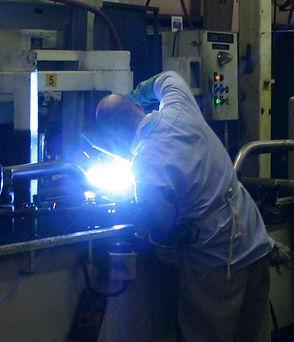 person using welding equipment