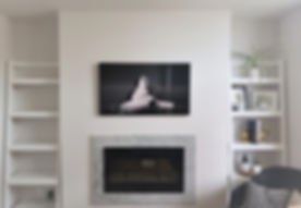 TV wall mounting above a fireplace