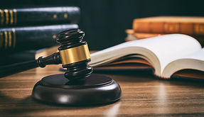 judge-gavel-on-a-wooden-desk-law-books-background-PAKUPF2.jpg