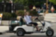 BG Waving in Golf Cart.jpg