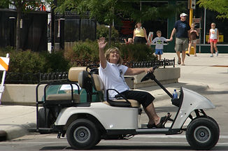 BG Waving in Golf Cart.jpg