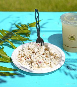 Macaroni salad on a blue table at Hana F
