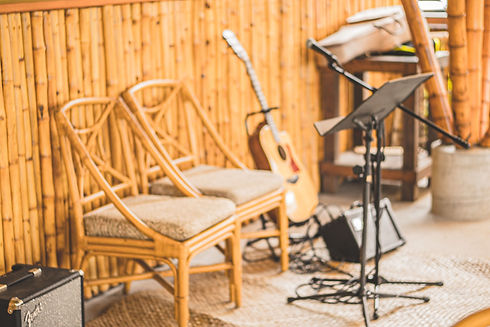 Guitar and Microphone on stage at The Bamboo Hale at Hana Farms