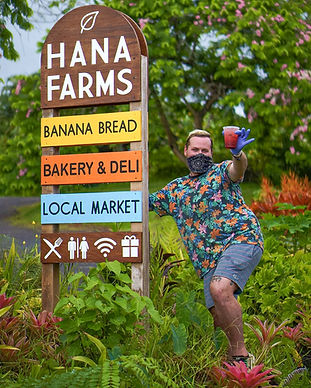 Hāna Farms Stand Signage and Employee.jp