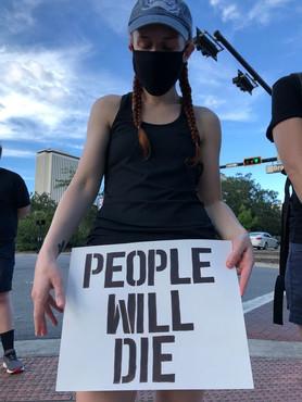 PPTSA Protestor Holding Sign