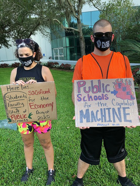 PPTSA Protestors Holding Signs