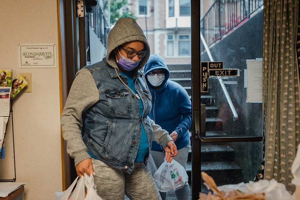 Jeanette Ortiz, left, and her mother, Miriam Morales, pick up food from the Lehigh Valley Second Harvest food pantry in Allentown on Friday.