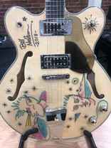 The guitar raffle prize