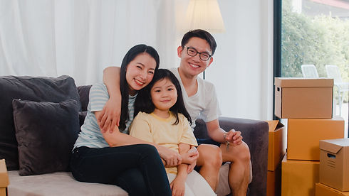 happy-asian-young-family-homeowners-boug