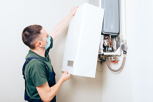 plumber-attaches-trying-fix-problem-with-residential-heating-equipment-repair-gas-boiler (