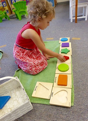 Student learning shapes at Montessori On The Lake