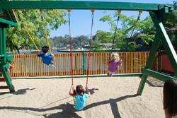 Children on swings at Montessori On The Lake