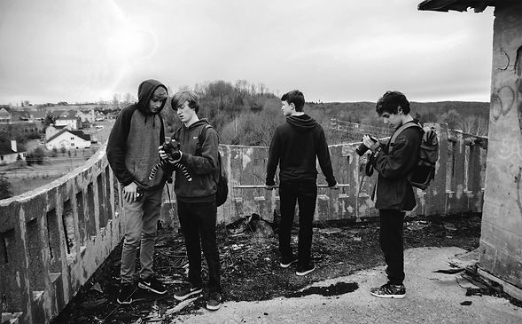 young-photographers-looking-at-cameras (