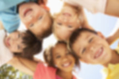 Group Of Children Looking Down Into Camera_edited.jpg