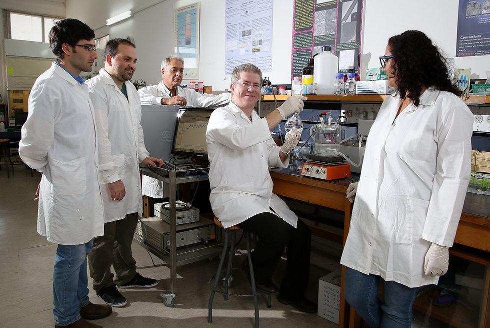 Noam Eliaz w Lab Staff.jpg