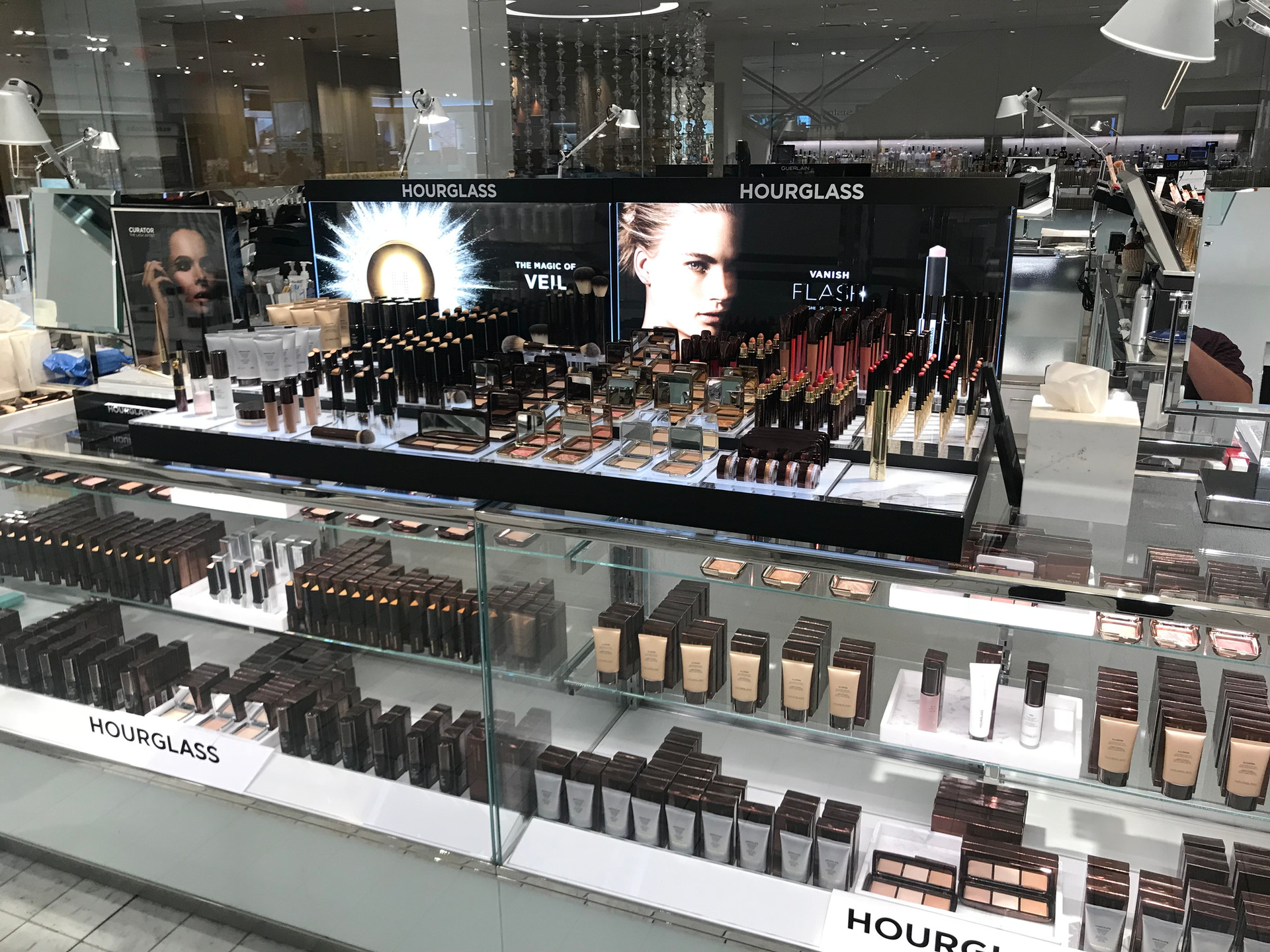 Luxury Beauty Display Updates - Duratrans Graphics - Acrylic Product Pedestals - Hourglass Cosmetics at Neiman Marcus