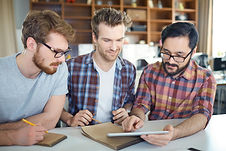 Three-young-men-in-modern-office-400969.
