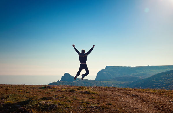 Celebration_man-leaping-off-of-cliff_DPC