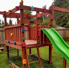 Modified Playset with Rock Climbing Holds and Interchangle Swings