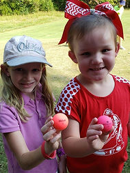 2 girls golf balls.jpeg