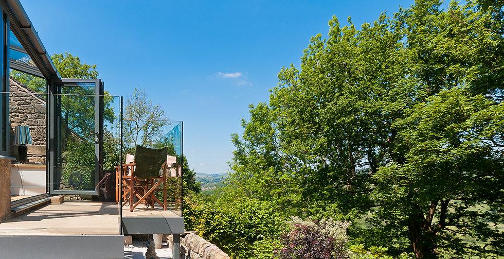 Bi-Fold Conservatory & Glass Balcony VI.