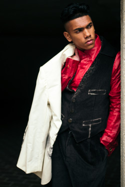 Cream jacket, black waistcoat, red shirt