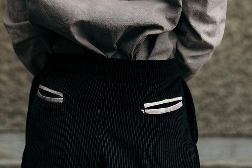 Black velvet pinstripe trousers