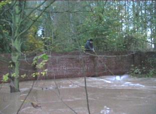 Water under the bridge (flood) 1998 [video still]