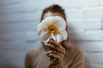 white-poppy-in-hand.jpg
