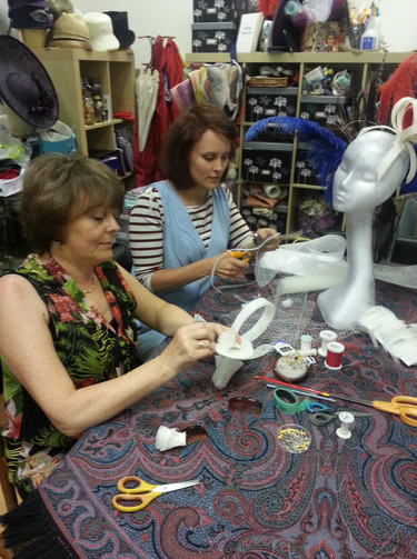 Mother and daughter making headpieces to wear for a special occasion