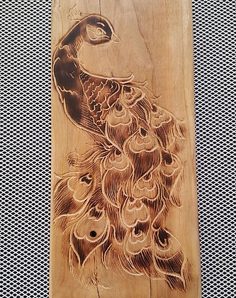 Upcycled palet board (engraved and burned peacock design)