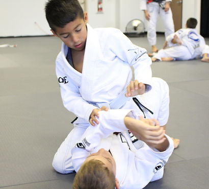 Learn how to escape bad positions in our kids jiu-jitsu classes.