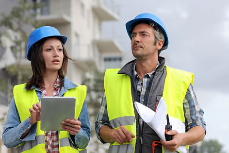 Two construction workers having a discussion on the construction site. OHS Communication is a part of the General Construction Induction Training, also known as the White Card or Red Card. Get your training done in Melbourne or Dandenong.