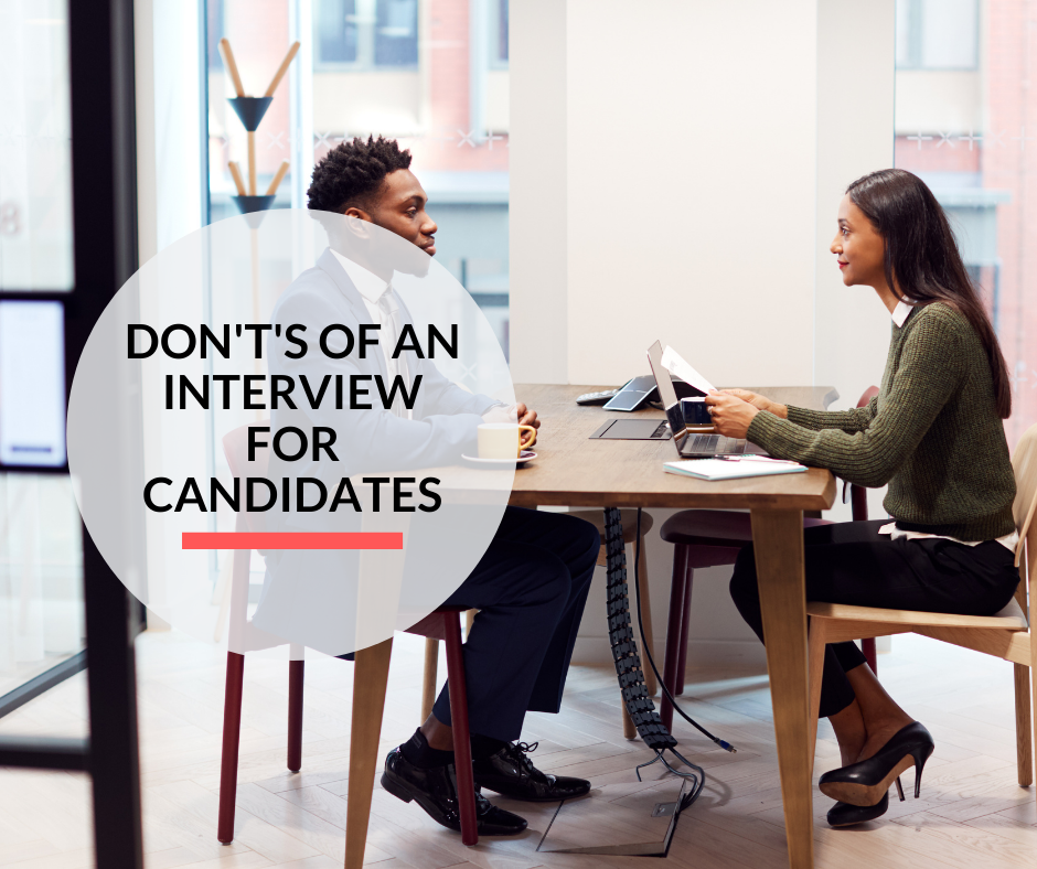 A lady conducting an interview of a man while reading from his resume.