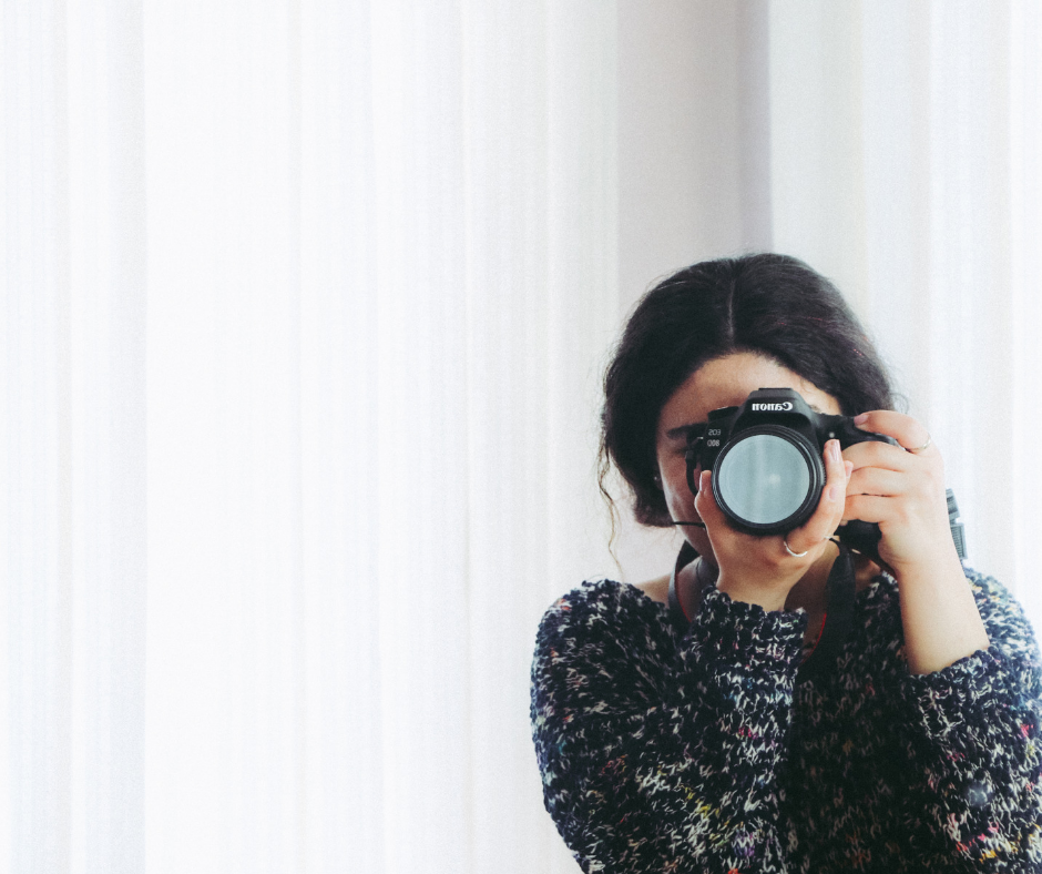 A lady pursuing her passion of photography with her camera.