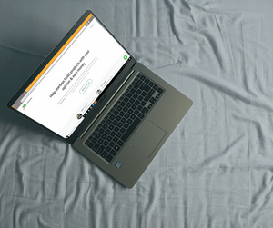 A laptop lying on the bed displaying the Ping Pong user testing website.