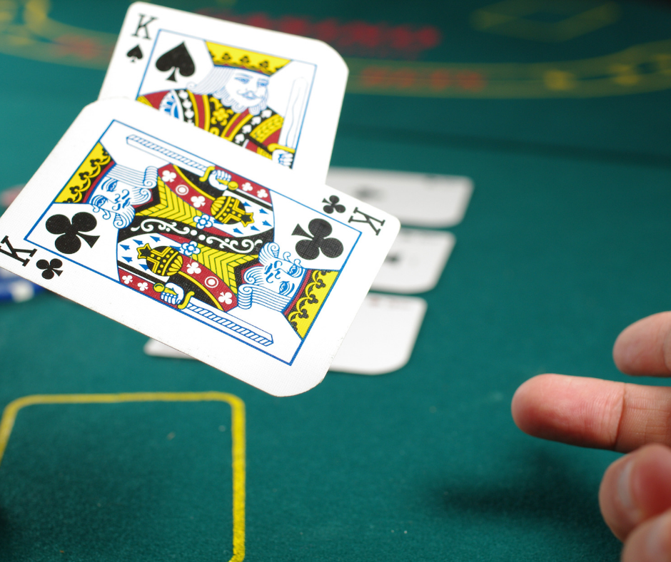 A man tossing cards in a casino.