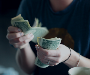 A lady counting her money before she spends it.