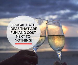 Two champagne glasses by the beach being enjoyed by a couple on a date.