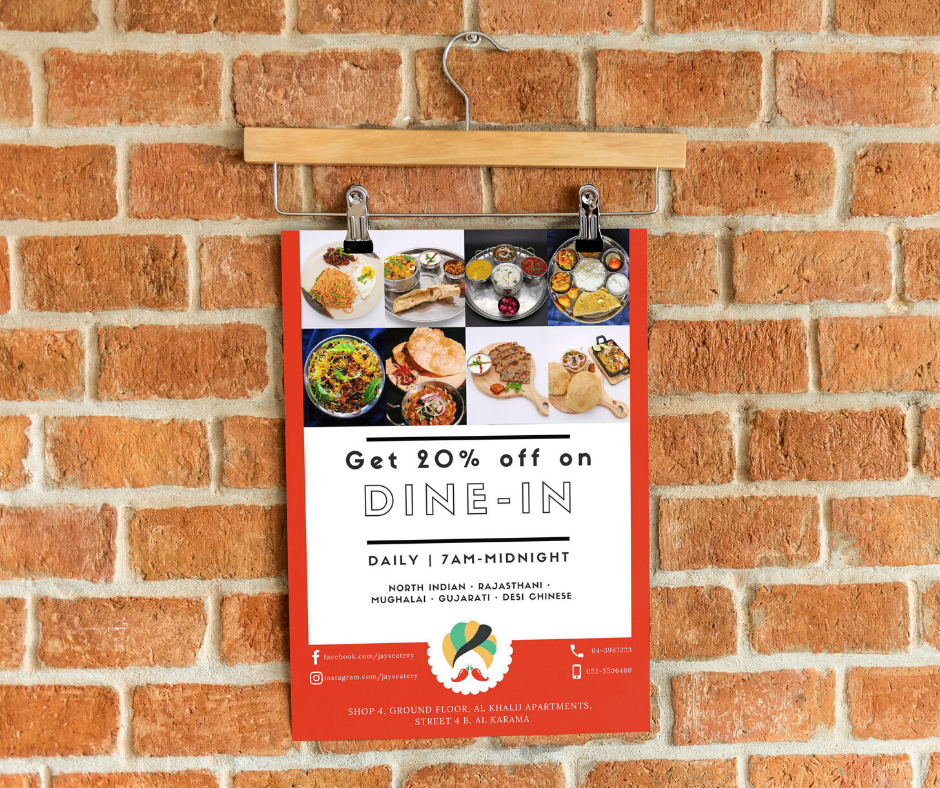 A poster of a restaurant hanging on a wall.