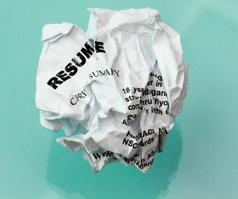 A resume with plenty of mistakes discarded and thrown away.