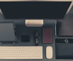 An image of all possessions owned such as a computer, phone, iPad, sunglasses and a wallet.